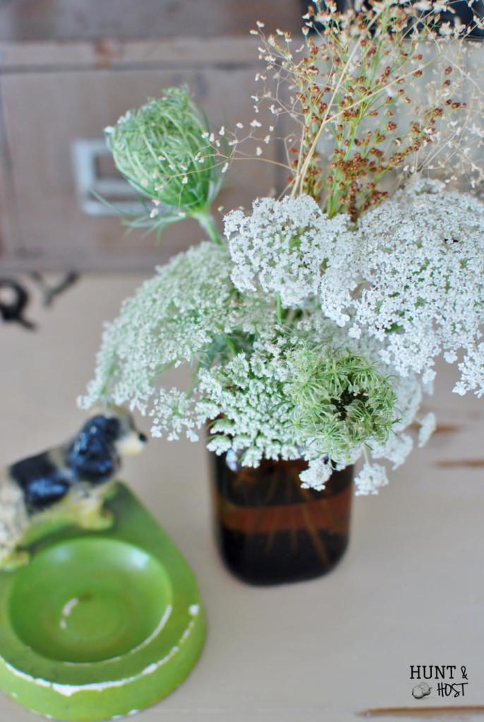 Wild flowers arranged in tobacco jars. www.huntandhost.net