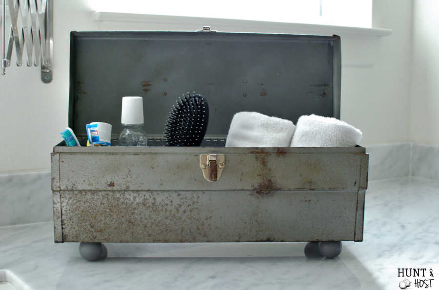 This rusty old toolbox gets a makeover into a boy's bathroom storage solution. www.huntandhost.net
