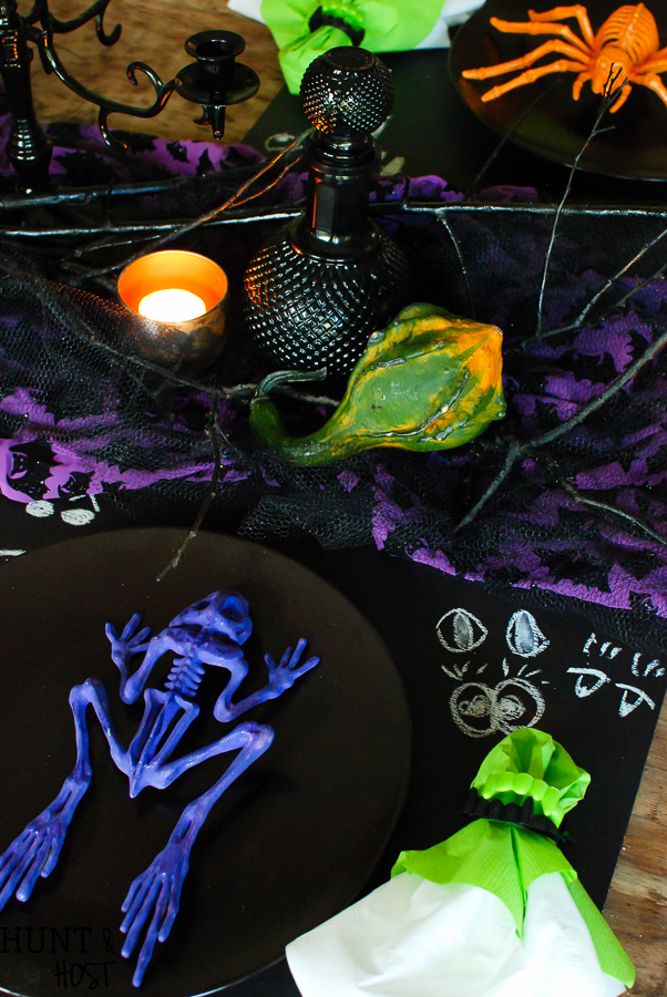Dollar store crafts turn into a spooky fun Halloween table setting! Check out these easy and inexpensive Halloween ideas.