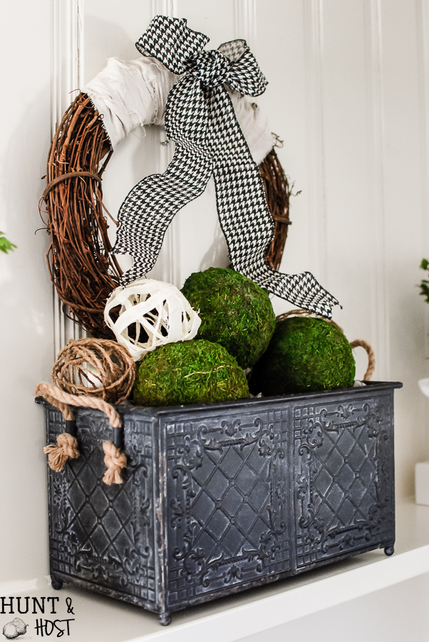 A fresh Spring mantel with DIY decorative balls. Bright, cheery and neutral spring décor you can make yourself!