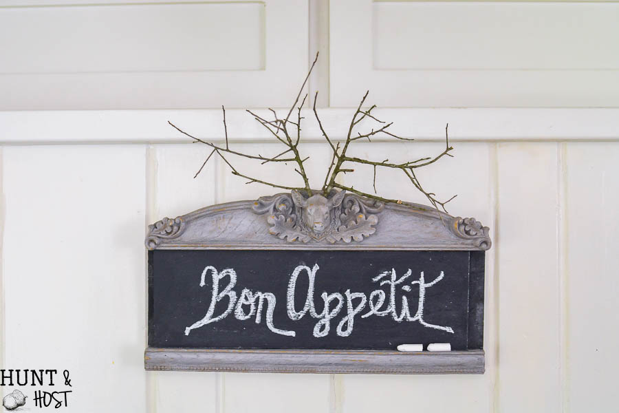This thrifty find gets made into a creative chalkboard, when in doubt chalkboards always look great! This deer head has the cutest branch antlers!