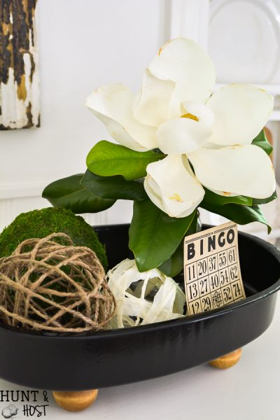 This old enamel pot lid without it's pot gets a makeover into a footed tray. Perfect for indoor or outdoor décor and the easiest DIY ever!