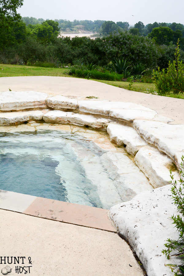 Visit the garden of a sleek rustic modern home with breathtaking views around every corner, agave and native vegetation, infinity pool and pecan orchard all overlook the Brazos River in the distance.