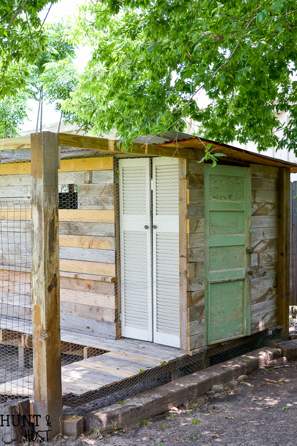 The chicken coop is complete, well, except for the chickens! The rabbits got an upgrade too with a large yard for a rabbit run. Salvaged materials make this space look like it's been there forever!
