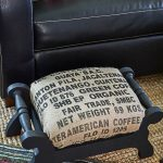 This is the cutest makeover! A cheap garage sale stool covered in coffee sack burlap - love it!