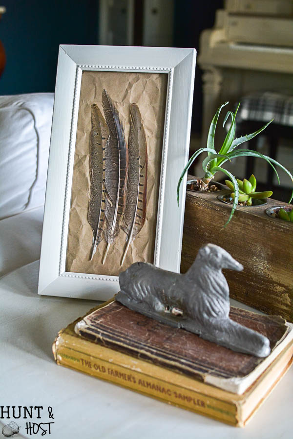 A great gift for guys this DIY small peasant art is easy and inexpensive to make from Pheasant feathers!