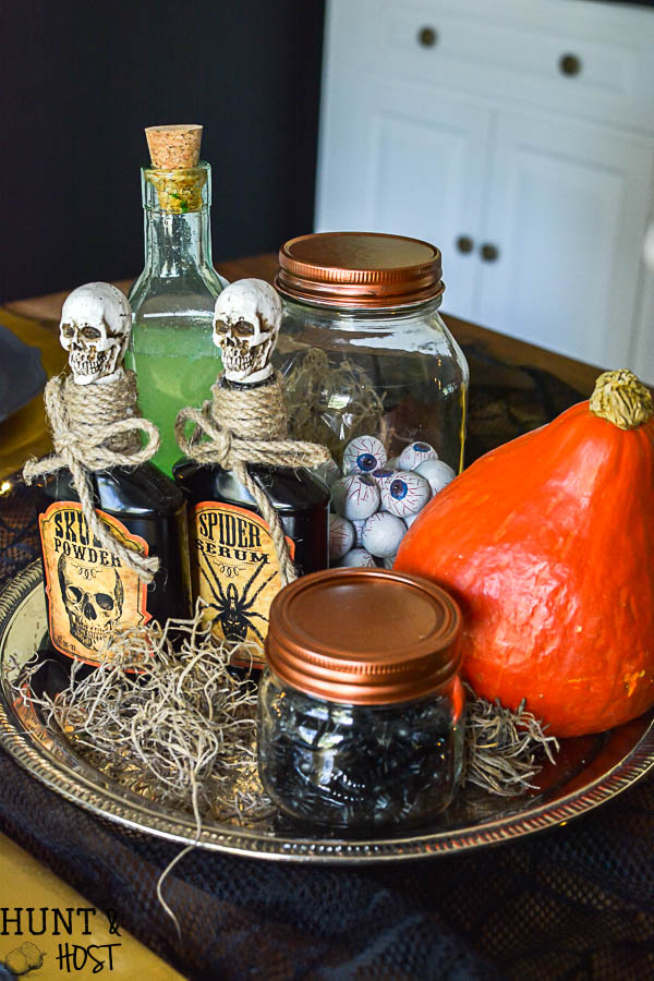 Halloween has gone glam! This crazy lady scientist glam Halloween table setting is so fun, full of fantastic Halloween decorating ideas and Halloween DIY. Featuring zombie flamingos being concocted! Plus Cost Plus World Market Halloween photo contest information.