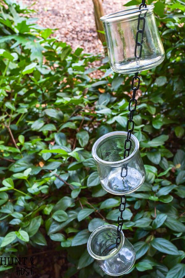 DIY rain chain tutorial, easy and inexpensive oui yogurt jar crafts. This rain chain makes a rainy day beautiful!