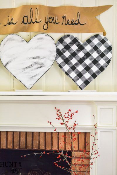 This giant DIY for Valentine's Day can be made in any size and would be great for other holidays! DIY Valentine's Day decor hearts are easy to style to your decor, black and white buffalo check and plaid shirt patterns add a fun touch instead of traditional Valentine pink!
