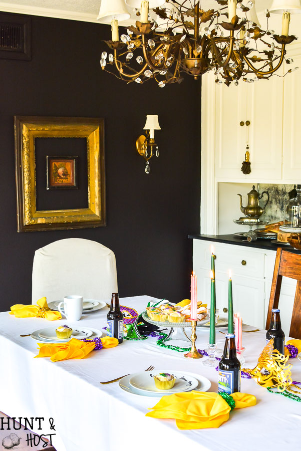 """A classic Mardi Gras table and traditions full of New Orleans flair. An easy DIY plate decoration, """"laissez les temps rouler"""" No Mardi Gras party is complete without king cake and café du monde coffee. Get your Mardi Gras beads and doubloons out for this festive big parade party!"""