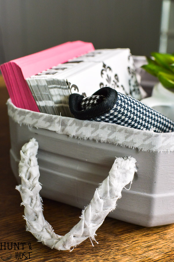Turn your empty kitty litter jugs into cute storage buckets. Upcycling empty containers for inexpensive DIY organizing is quick and easy!