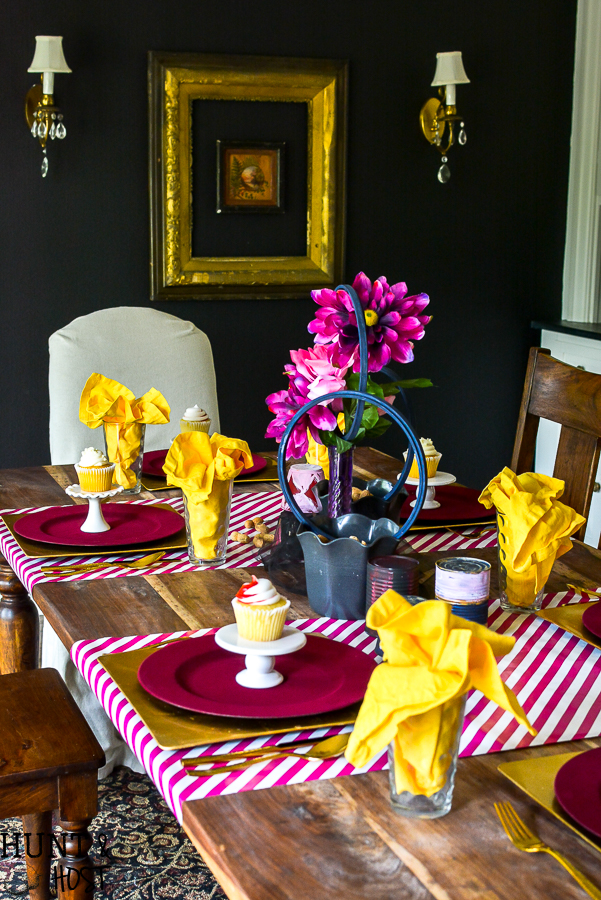 Create a table setting inspired by The Greatest Showman! Perfect for a glam circus theme dinner or just for a cute Greatest Showman tablescape to entertain the family. Anne's pink hair and the smell of peanuts round out this glitzy gold and fuchsia party scene.