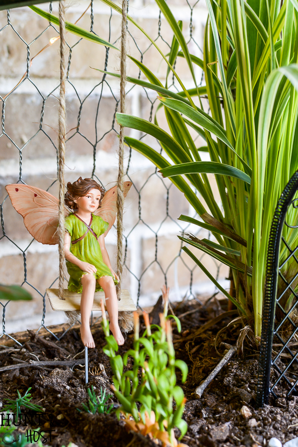 Take your fairy garden vertical with this natural fairy garden setting, complete with an actual fairy garden and swimming hole. This fun summer project to do with the kids will get your creativity going and green thumb working. Make a mini fairy garden for your house or porch with these precious fairy supplies and easy miniature ideas!