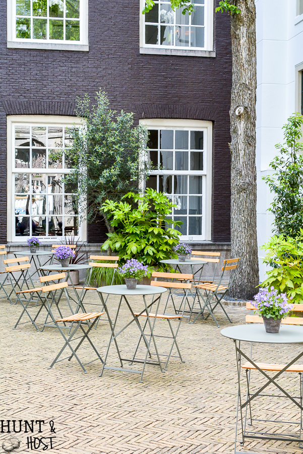 A trip in Amsterdam through pictures. See some fun things to do firsthand as we explore this canal city in The Netherlands through photos! Visit the Amsterdam Zoo, gardens, Hotel Dylan and a food tour through Albert Cuyp Market. There are tons of things to do in Amsterdam!