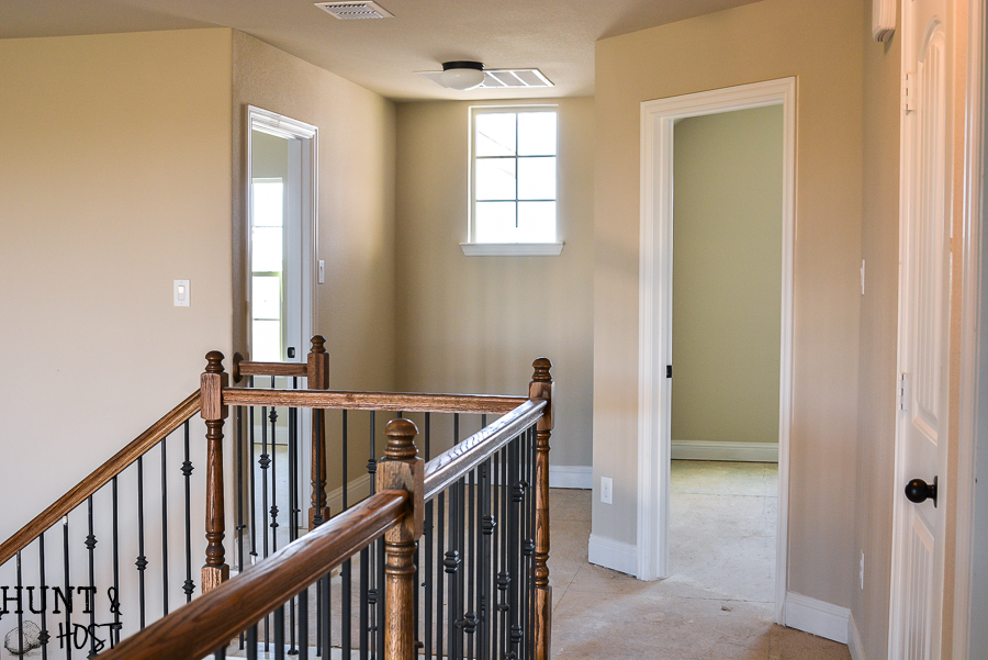 Before pictures of a very vanilla builder grade home ready to get a personal and cozy makeover on a budget full of DIY ideas, tips and tricks. Follow along this cookie cutter home makeover!
