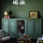 This plain jane white room gets a vintage makeover with moody green walls and a vintage bookcase painted to match. #moodygreen #bestgreenpaint #vintagelibrary #bookcase