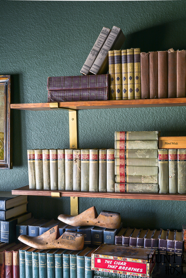 Built in cabinets can be expensive, read all the reasons to use open shelving vs built-in storage for a more stylish and affordable home. Make your study or library room cozy and charming with this moody green paint and faux built-in. #fremchcountrycottage #libraryroom #openshelf #storageideas #DIYcabinet #DIYstorageidea #frenchcountryoffice