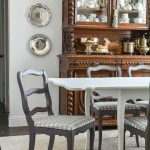 This $40 Facebook Marketplace find gets a makeover. See how this filthy drop leaf dining room table goes to French Country gorgeous in no time. With large print houndstooth fabric and a deep dark paint job these charis are stunning. #frenchcountry #diningroom #cottagedinginroom #farmhousediningroom #paintedfurniture