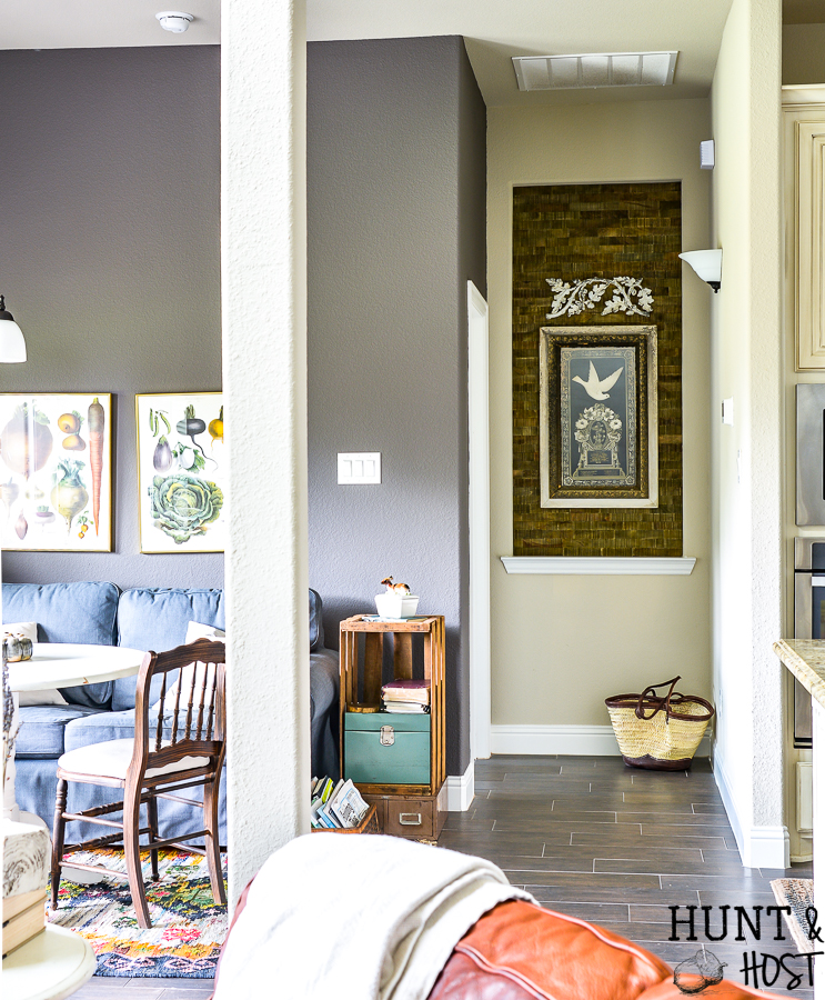 Taking your boring art niche up a notch with this quick afternoon makeover. How to install peel and stick wood tiles to decorate a small space with rustic style. #buildergradehome #spechouse #homeupgrade #woodwall #artniche