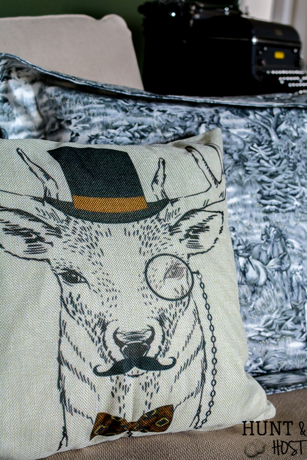 This dapper deer pillow is a must have for a whimsical french country vibe or farmhouse style living room. Add charm with this deer pillow without spending a ton of money! #deerpillow #farmhousepillow #vintagevibe #dapper #eclecticpillow
