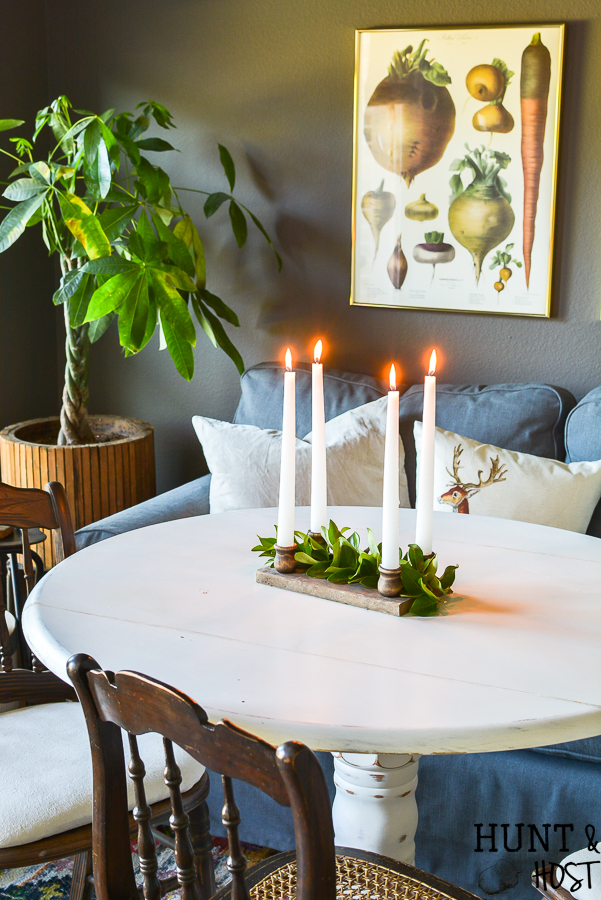 This DIY aged barn wood decor idea is so simple. Make a dual use tray out of DIY barn wood for a festive candle riser or gorgeous rustic centerpiece. #barnwood #barnwooddecor #barnwoodproject #candleriser #centerpieceidea