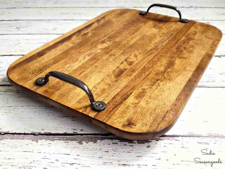 Wonder what to do with old cutting boards and butcher blocks? These DIY upcycled cutting board ideas are perfect for a quick change to your thrifted butcher blocks and old wood boards!