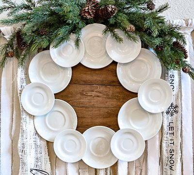 Make your own gorgeous wreath from vintage ironstone plates or hotel china. This DIY ironstone plate wreath tutorial is so simple and is perfect for vintage farmhouse decor. #ironstone #vintagewreath #roundtop #antiquesweek #wreathmaker