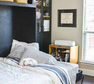 We added a Murphy bed to the craft room/guest bedroom and it is a space saver for sure. See how we paired the IKEA Billy bookcase with a custom Murphy bed for an office/craft/spare room with tons of functional storage and style. #IKEA #craftroom #murphybedidea #WhereWomenCreate #craftroomidea