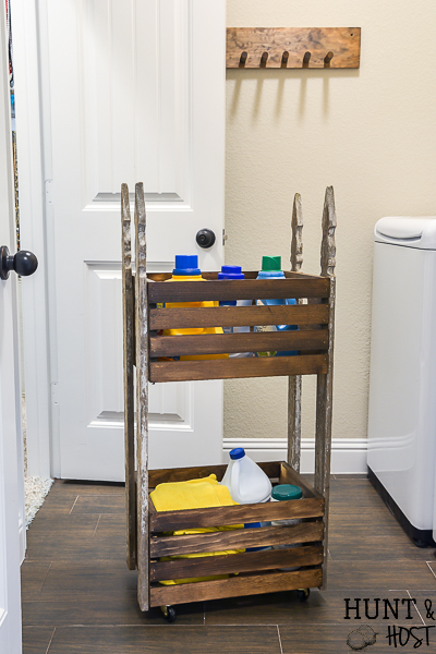 Make your own DIY vintage style laundry cart to help organize your laundry room on a budget with style. This farmhouse laundry idea will help you enjoy doing the laundry! #vinatgestyle #laundryorganization #christianinspiration #laundrycartonwheels