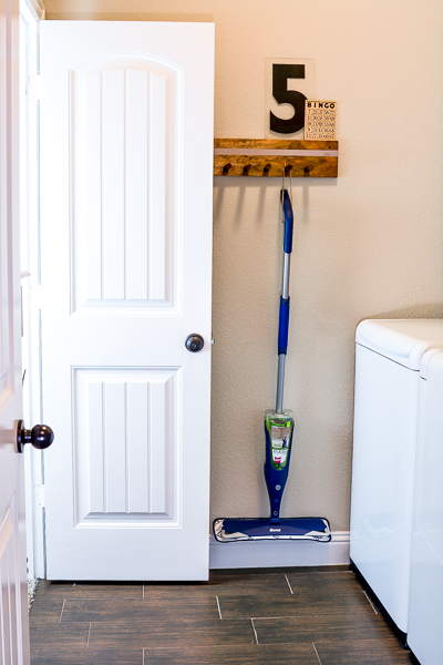 Here are a few simple DIY projects to organize your laundry room on a budget and keep you house clean this year - joyfully! Make your laundry room look beautiful and you will enjoy your time there more. Plus get the right cleaning tools to make your house cleaning easy, like the Bona spray mop that I am in love with. See how vintage items can cozy up a laundry room and create unique storage solutions for laundry room organization on a budget everyone can get behind. #laundryroom #organizationhack #diyorganization #bona