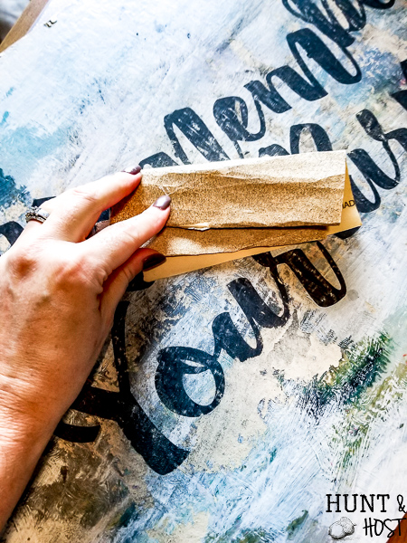 If you come across old artwork in thrift stores and wonder how you can re-purpose it, this is a great idea on how to switch up old art prints into modern DIY typography art with a free download cut file to help. #cricutcutfile #thriftstorefind #DIYartwork #pctureframerepurpose #vintagestyle